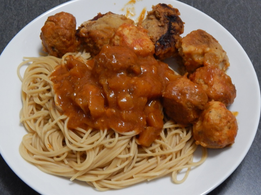 Turkey meatballs with a tomato/pineapple sauce on spaghetti, with a side of dumplings
