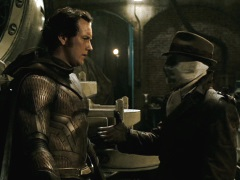 Rorschach and Dan shaking hands after having a brief and awkward but touching moment.